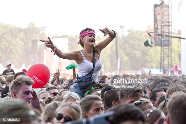 A visitor enjoys a concert during the second day of Lollapalooza Festival at the Treptower Park on September 11 2016 in Berlin Germany