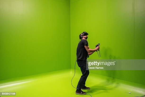 A visitor enjoys a HTC VR virtual reality experience during the Mobile World Congress 2017 on the opening day of the event at the Fira Gran Via...