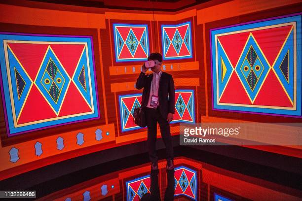 Visitor enjoys a Virtual Reality experience at the Saudi Telecom Company booth on day 2 of the GSMA Mobile World Congress 2019 on February 26, 2019...