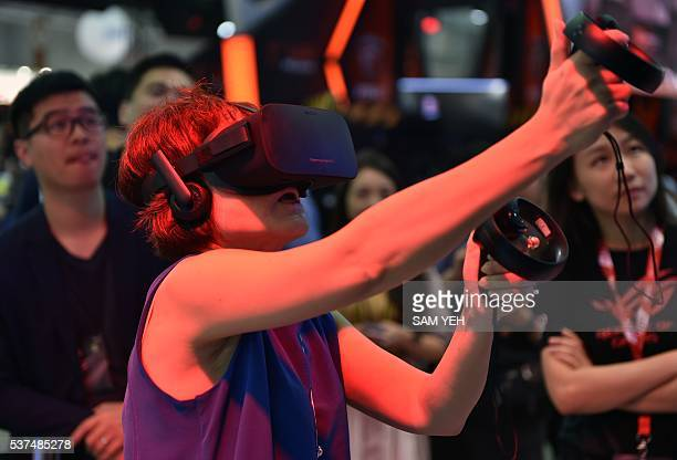 A visitor enjoys a visual reality headset during the annual Computex computer show in Taipei on May 31 2016 Reducing errors made during surgery...