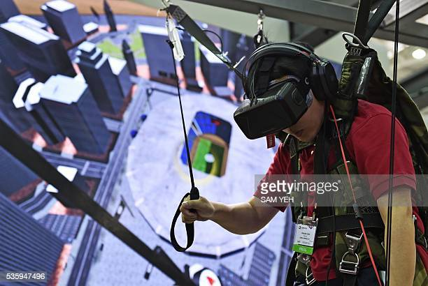A visitor enjoys a visual reality headset simulating a parachutist during the annual Computex computer exhibition on May 31 2016 More then 5000...