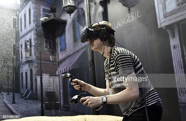 A visitor enjoys the HTC Vive visual reality headset during the annual Computex computer show in Taipei on June 1 2016 Reducing errors made during...
