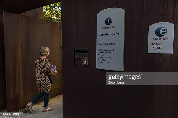 A visitor enters a Pole Emploi job center the French national employment agency in Cahors France on Thursday Aug 28 2014 French jobless claims rose...