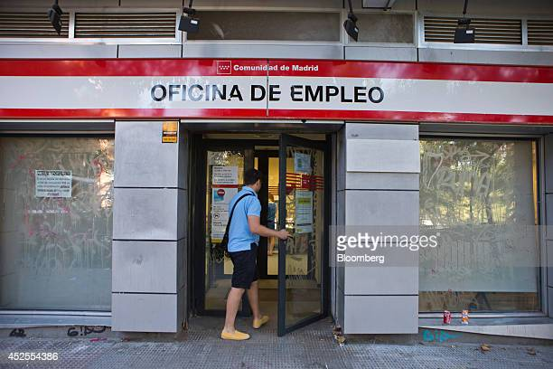 A visitor enters an employment center in Madrid Spain on Wednesday July 23 2014 While unemployment figures tomorrow will show that about a quarter of...