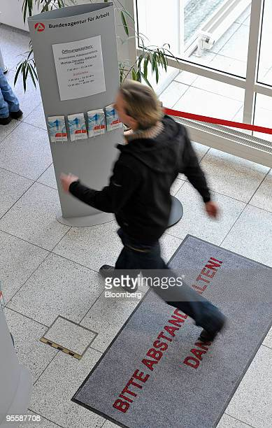 A visitor enters an unemployment office or Arbeitsagentur in Rosenheim Germany on Tuesday Jan 5 2010 German unemployment unexpectedly fell in...