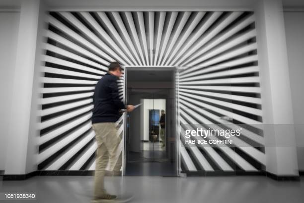 A visitor enters the exhibition entitled 'LSD the 75 Years of a Problem Child' at the Swiss National Library on September 21 2018 in Bern Lysergic...