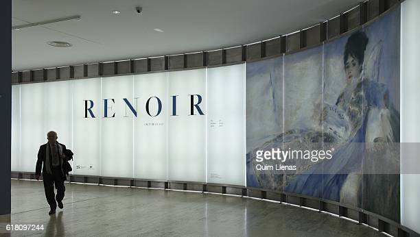 A visitor enters the exhibition 'Renoir Intimidad' at the ThyssenBornemisza Museum on October 17 2016 in Madrid Spain This exhibition the first...