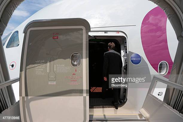 A visitor enters the forward cabin access door to the cockpit deck on an Airbus SAS A380 aircraft operated by Qatar Airways Ltd on day two of the...