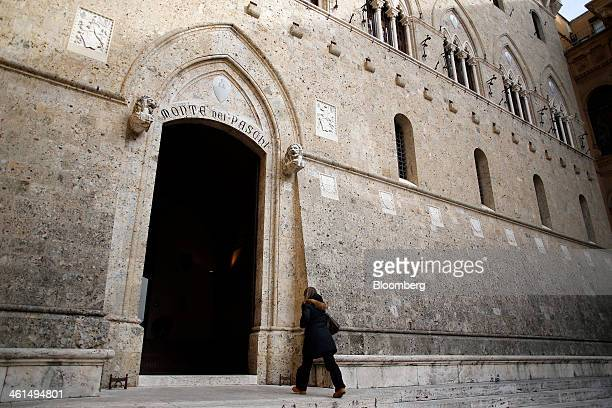 A visitor enters the headquarters of Banca Monte dei Paschi di Siena SpA in Siena Italy on Wednesday Jan 8 2014 Monte Paschi the bailed out Italian...