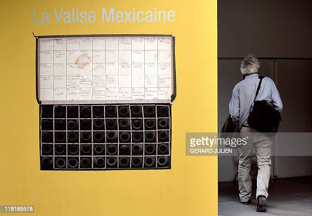 A visitor enters to attend the exhibition 'the Mexican suitcase' in July 4 2011 during the 42nd annual Rencontres d'Arles photography festival in...