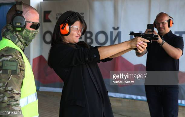 Visitor examines a Kalashnikov handgun at the presentation prior to the International Military Technical Forum Army 2020 in Patriot Park on August...