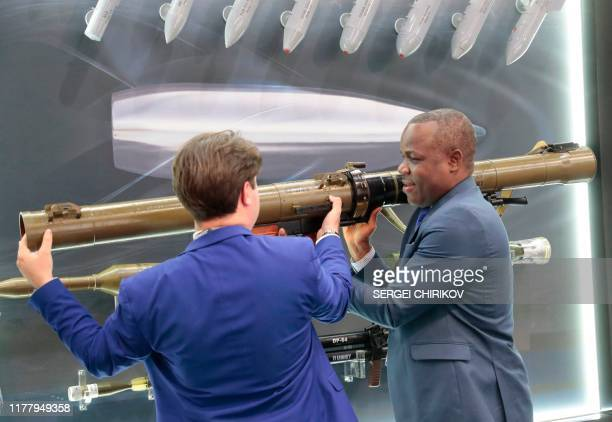 Visitor examines a Russian made rocket-propelled grenade launcher RPG-29 during the Russia-Africa Economic Forum Exhibition on the sidelines of the...