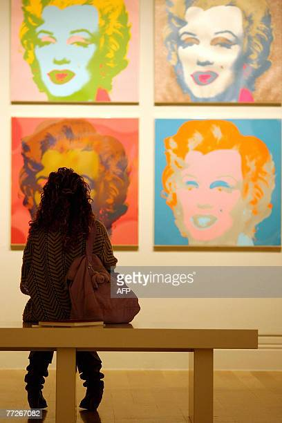 A visitor examines Andy Warhol's Marilyn Monroe 'Marilyn 1967' at the Pop Art Portraits exhibition National Portrait Gallery in central London 11...