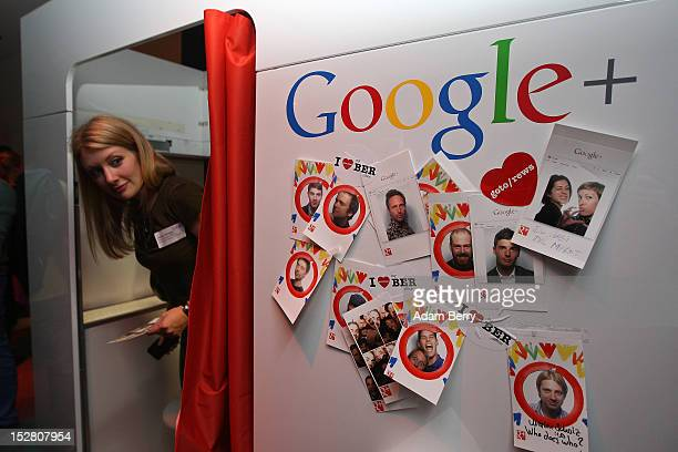 A visitor exits a photo booth on September 26 2012 at the official opening party of the Google offices in Berlin Germany Although the American...