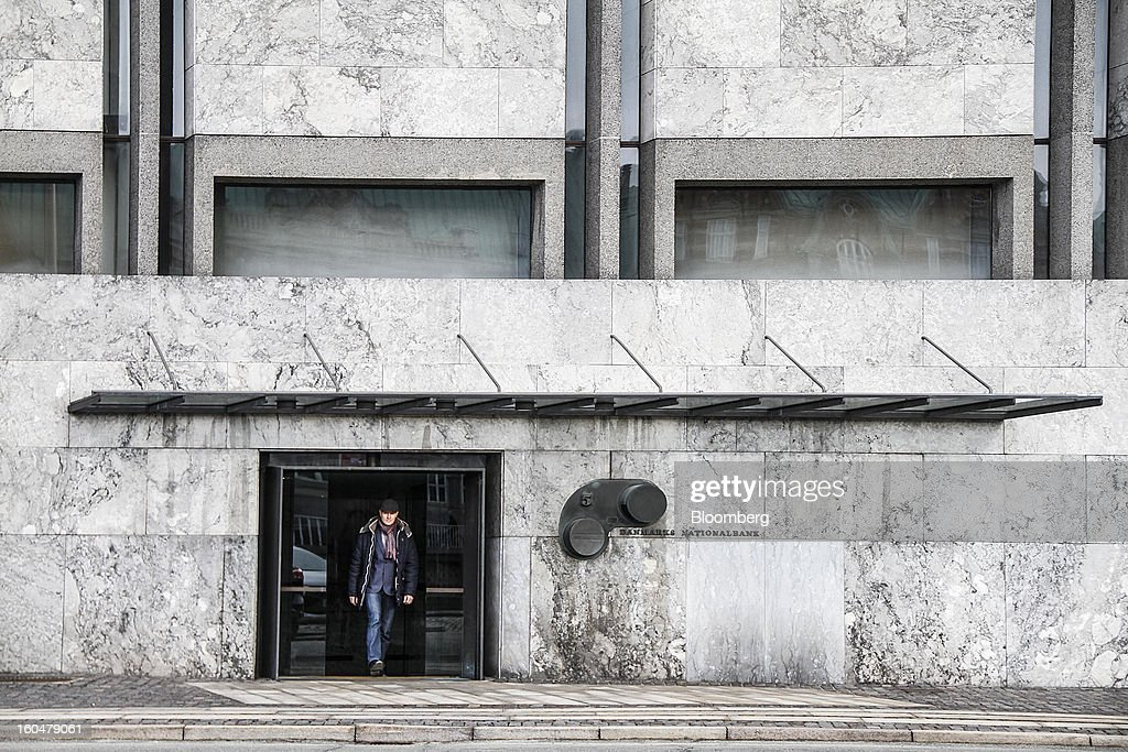 A visitor exits the headquarters of Denmark's central bank in Copenhagen, Denmark, on Friday, Feb. 1, 2013. Danish regional banks are struggling to emerge from a burst property bubble that's forced the government resolution agency to take over a dozen lenders after losses on commercial and agricultural loans wiped out capital. Photographer: Freya Ingrid Morales/Bloomberg via Getty Images