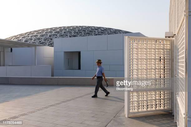 Visitor exits the Louvre Abu Dhabi museum on Saadiyat Island in Abu Dhabi, United Arab Emirates, on Wednesday, Oct. 2, 2019. Abu Dhabi sold $10...