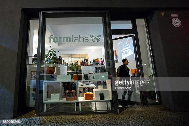 A visitor exits the offices of 3D printing and design company Formlabs GmbH in Berlin Germany on Tuesday Nov 8 2016 The 3D printing process can cut...