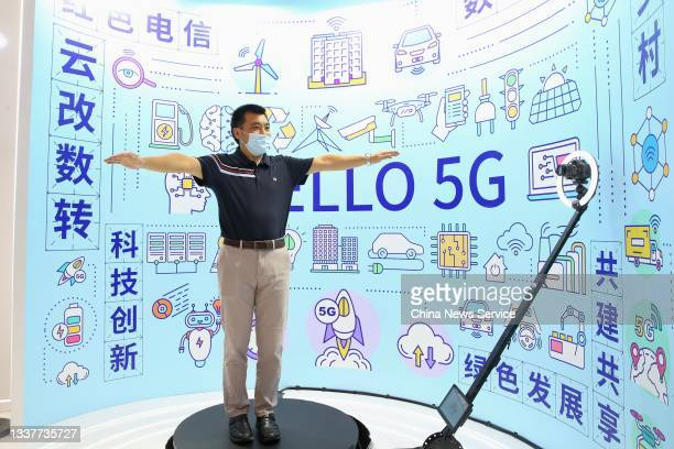 Visitor experiences 5G stereo photography during 2021 World 5G Convention at Beijing Etrong International Exhibition & Convention Center on September...
