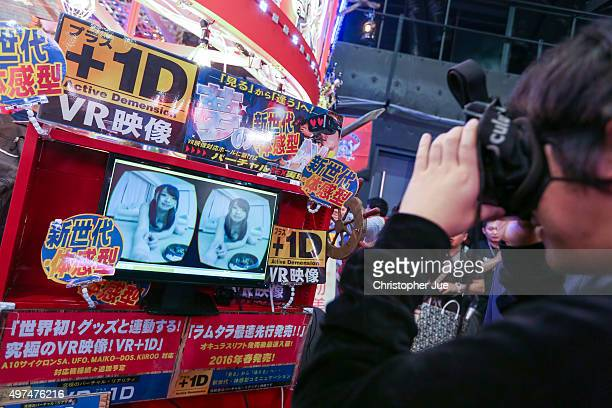 A visitor experiences an adult virtual reality video during the Japan Adult Expo at the Toyosu PIT on November 17 2015 in Tokyo Japan At the Japan...