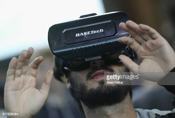 A visitor explores a Virtual Reality landscape with VR goggles at the 2016 Berlin Maker Faire on October 1 2016 in Berlin Germany The Maker Faire...