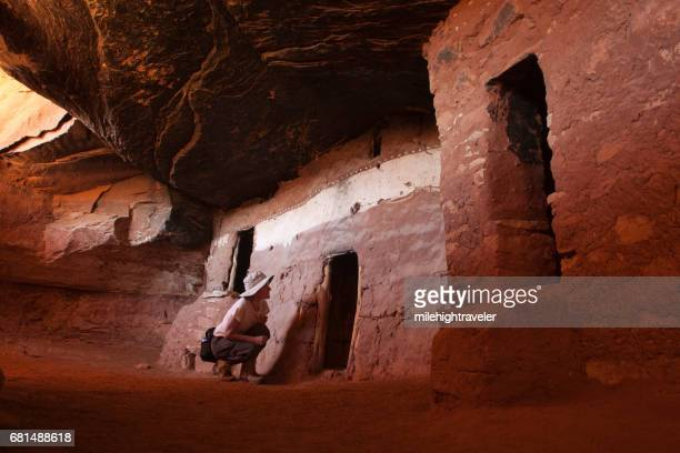 Visitor explores Bears Ears National Monument Cedar Mesa Moonhouse puebloan ruins Utah