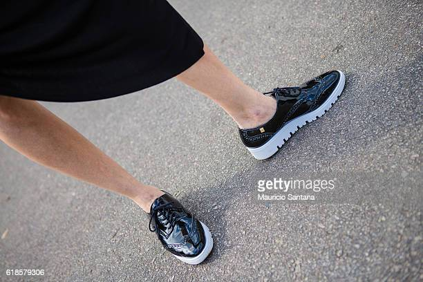 A visitor fashion detail shoes poses during Sao Paulo Fashion Week Trans 42 SPFW Fall / Winter 2017 on October 26 2016 in Sao Paulo Brazil