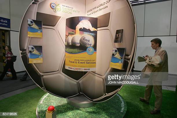 A visitor gathers information from a stand advertising the 2006 Football World Cup hosted by Germany at Berlin's International Tourism Fair 15 March...