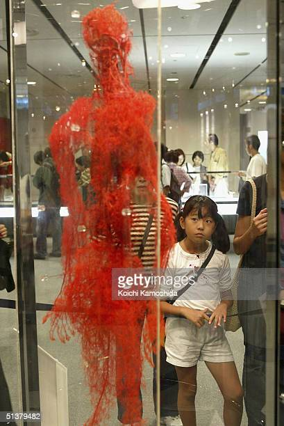 Visitor gazes at a preserved plastomic Cardiovascular System at the Mysteries of the Human Body exhibition which displays some 170 specimens on...