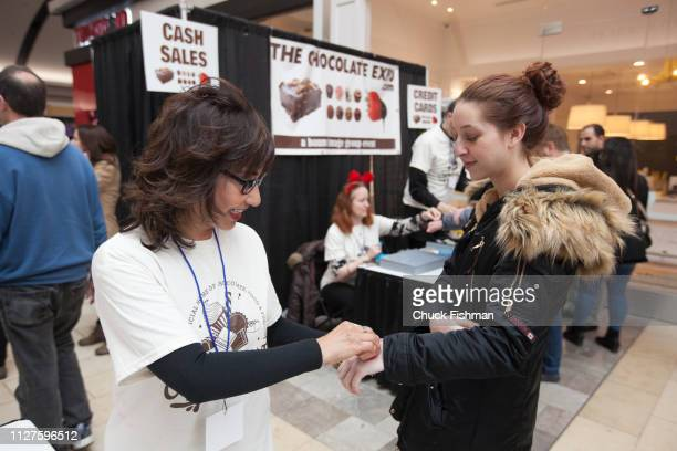 A visitor gets her hand stamped for entry' at The Chocolate Expo at Garden State Plaza Mall Paramus New Jersey January 2019