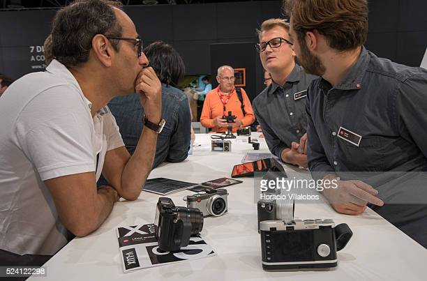 A visitor gets information at Leica pavilion in Photokina 2014 in Cologne Germany 18 September 2014 Photokina the world's leading imaging fair brings...