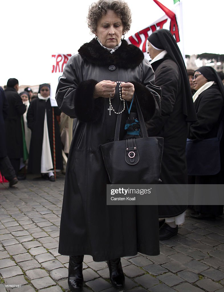 A visitor holds a rosary chain on February 24, 2013 in Vatican City, Vatican. Pope Benedict XVI is to deliver his last Angelus Blessing from the window of his private apartment to thousands of pilgrims gathered in Saint Peter's Square on February 24, 2013 in Vatican City, Vatican. The Pontiff will hold his last weekly public audience on February 27, 2013 before he retires the following day. Pope Benedict XVI has been the leader of the Catholic Church for eight years and is the first Pope to retire since 1415. He cites ailing health as his reason for retirement and will spend the rest of his life in solitude away from public engagements.