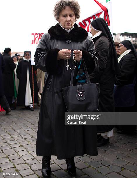 A visitor holds a rosary chain on February 24 2013 in Vatican City Vatican Pope Benedict XVI is to deliver his last Angelus Blessing from the window...