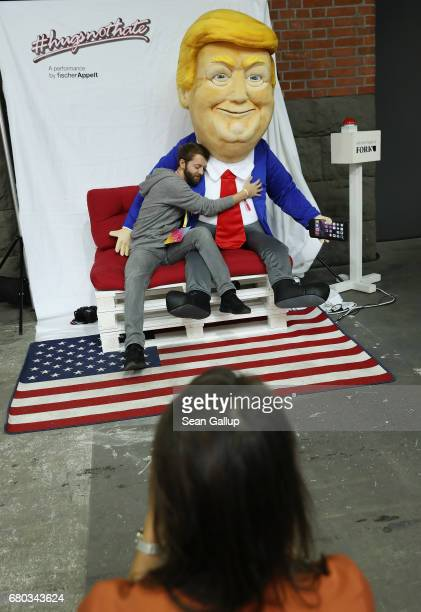 A visitor hugs an effigy of US President Donald Trump that was emitting pleasant statements under the hashtag hogsnothate at the Republica 17...