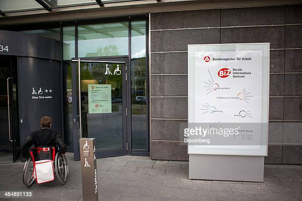 A visitor in a wheelchair arrives at a Agentur fuer Arbeit employment office in Stuttgart Germany on Monday April 14 2014 German unemployment fell...