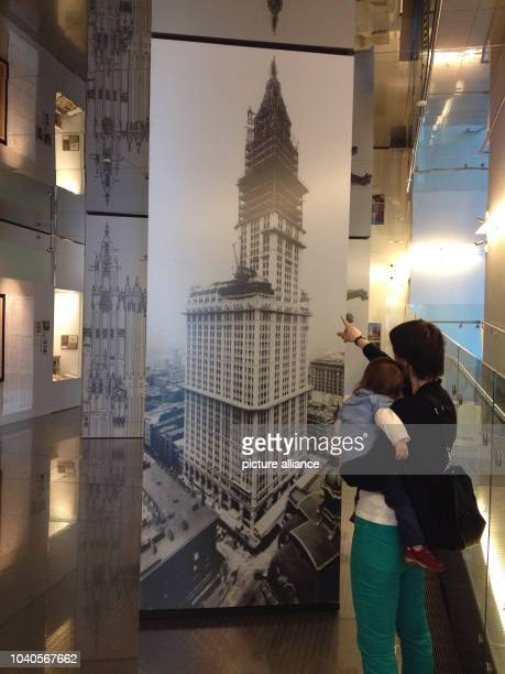 Visitor in the New Yorker Skyscraper Museum observes a history photograph of the Woolworth Building on Broadway in New York USA 13 April 2013 100...