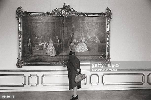 Visitor in the Schloss Charlottenburg in Berlin. Photography. Germany. 1961/62. [Besucherin im Charlottenburger Schloss in Berlin. Photographie....