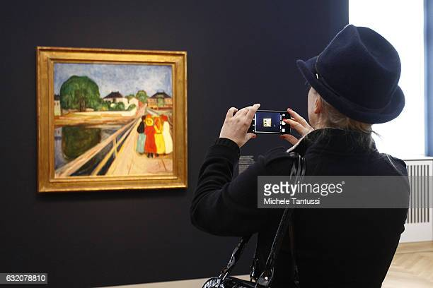 A visitor in the take a picture of the Painting of Edvard Munch The Girls on the Bridge the Barberini Museum during a press preview on January 19...