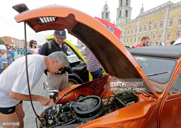 Visitor inspects the engine of a car parked in Mafra after the arrival of the parade of Citroen classic cars 2CV during the World 2017 2CV Meeting...