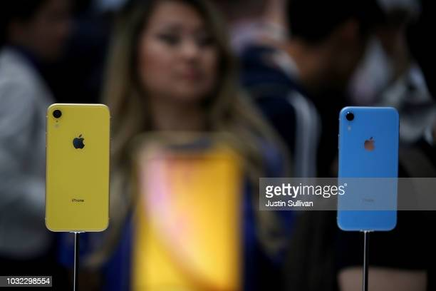 A visitor inspects the new Apple iPhone XR during an Apple special event at the Steve Jobs Theatre on September 12 2018 in Cupertino California Apple...