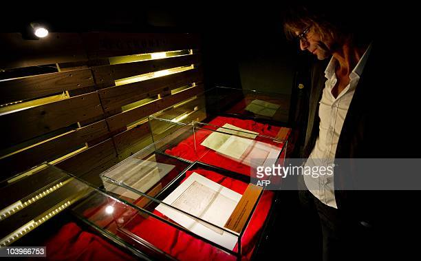 A visitor inspects the oldest share known so far of the VOC the company that helped Holland dominate world trade in the seventeenth century in the...