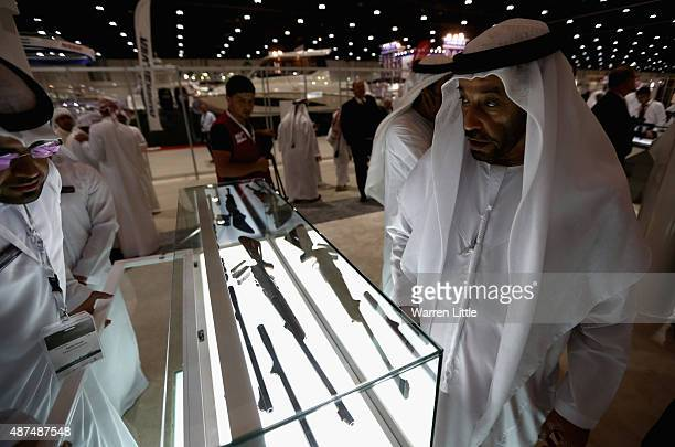 Visitor inspects the rifle selection at Abu Dhabi National Exhibition Centre on September 9 2015 in Abu Dhabi United Arab Emirates