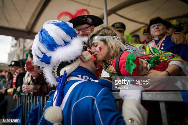 Visitor is kissed by a carnival member during Rose Monday parade on February 27 2017 in Cologne Germany Political satire is a traditional cornerstone...