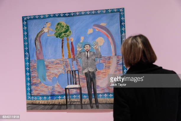 A visitor is pictured in front of ' A Play Within A Play' 1963 by David Hockney during a press preview for the British artist's retrospective at Tate...
