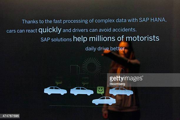 A visitor is reflected in a Hana database interface display inside the SAP AG Inspiration Pavilion at the company's headquarters in Walldorf Germany...