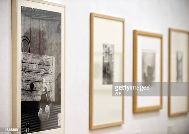 A visitor is reflected in Hungarianborn US photographer Andre Kertesz' Saint Gervais les Bains 1929 at the Kertesz retrospective at Berlin's...