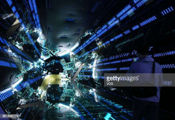 A visitor is seen in the 'time tunnel' at the big data demonstration center on April 26 2018 in Huainan Anhui Province of China