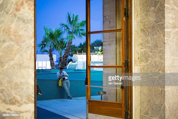 A visitor is seen outside the Palazzo del Cinema during 73rd Venice Film Festival on August 31 2016 in Venice Italy