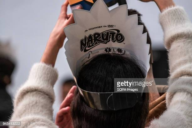 A visitor is seen wearing a crown of the Naruto comic Opening of the 36th Barcelona International Comic Fair from 12th15th April 2018 in Fira...