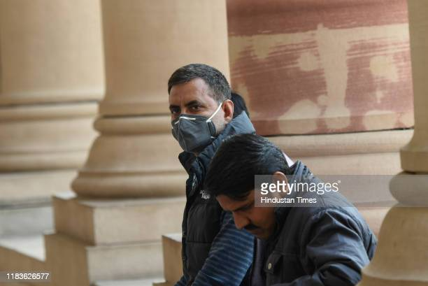 A visitor is seen wearing an antipollution mask to protect himself from the air pollution in the city inside Parliament House on November 20 2019 in...