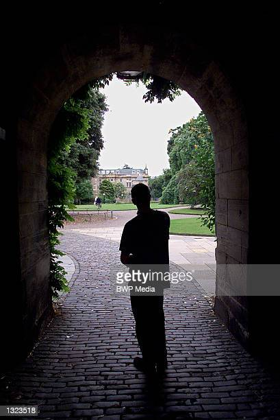 A visitor is silhouetted in an arched entrance to St Mary''s Quad July 7 2001 at St Andrews University in Fife Scotland Prince William is expected to...